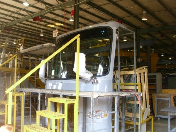 Windshield is installed at the Tiffin Motorhome Factory