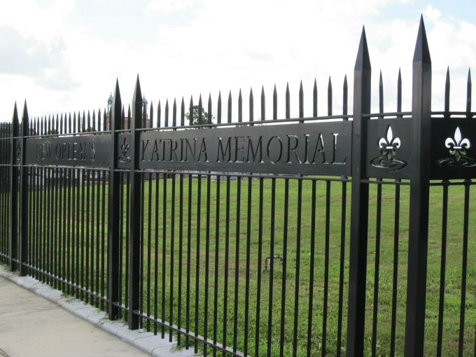 The imposing black wrought iron gate that surrounds the Katrina Memorial.