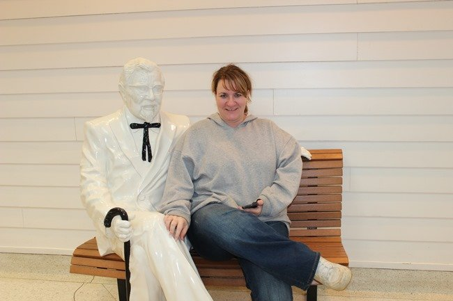 Posing with a statue of Colonel Harland Sanders