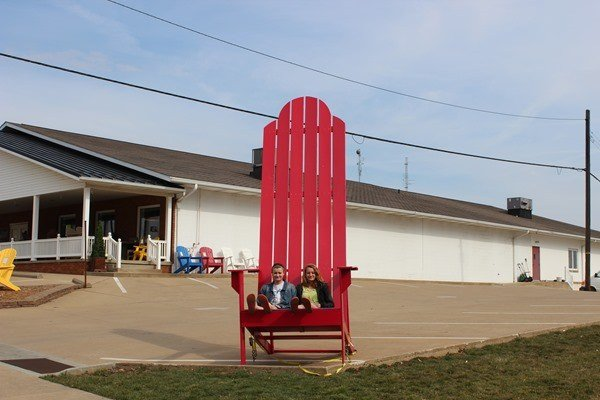 Having a seat in the Chair of Giants Roadside Attraction