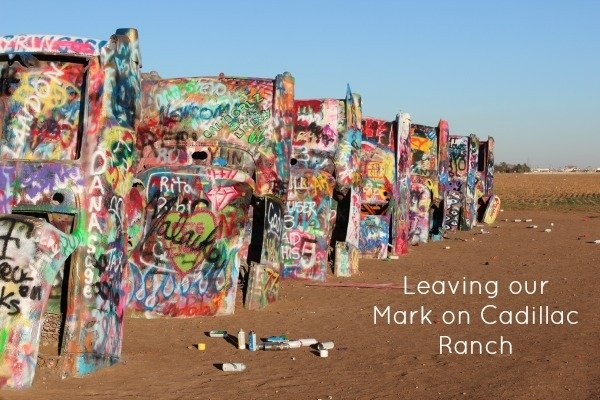 Leaving our Mark on Cadillac Ranch Roadside Attraction in Amarillo, Texas