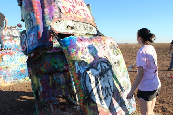 Spray painting at Cadillac Ranch