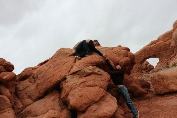 The boys playing at Arches National Park