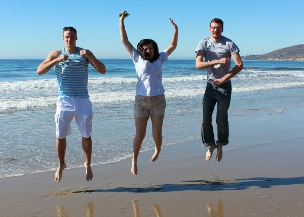 The kids jumping on the beach at El Capitan State Beach near Santa Barbara