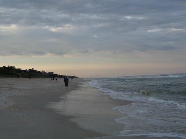 Walking along Mickler's Beach at sunset