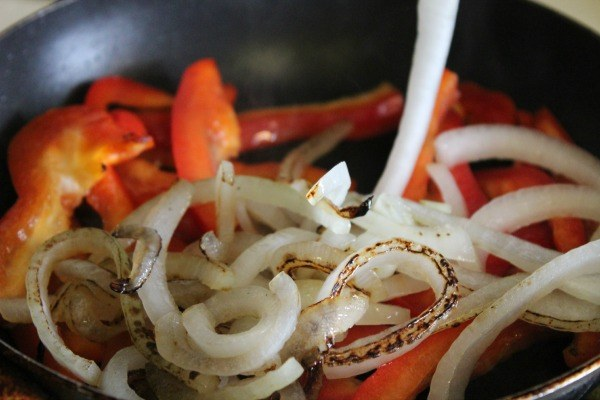 Saute red peppers and onions