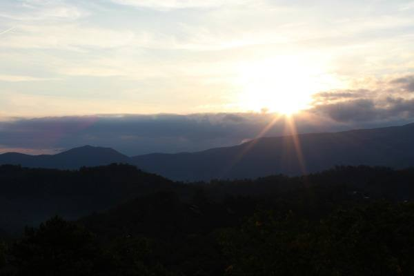 The sun rising over the mountains as seen from the deck at Bella Yani #MBSmokies