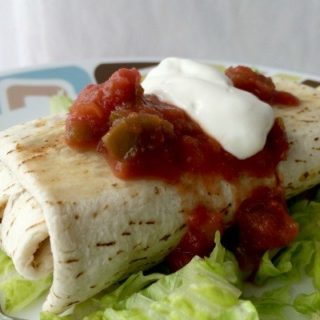 A PJ's Organics Skinny low fat chicken burrito- a delicious and quick meal for hotel stay.