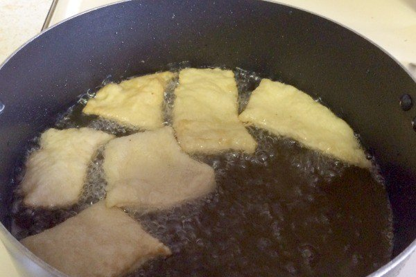 Fry the beignets in hot oil.