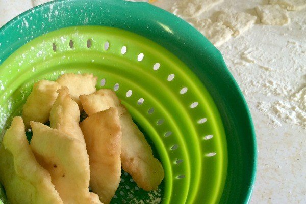 I tossed the beignets in a colander and shook off the excess oil.