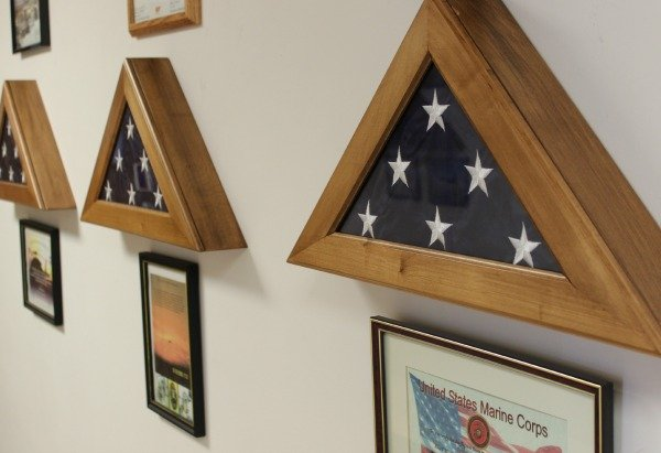 The walls inside the offices of Annin Flag Company in Coshocton are decorated with flags used by the Armed Forces.