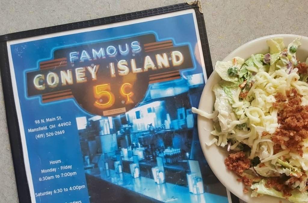 A menu from Coney Island Diner in Mansfield Ohio and a salad