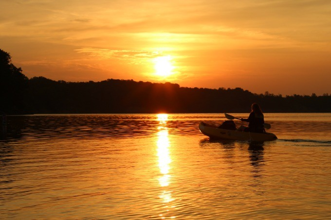 Kayaking before sunrise at Deer Creek State Park Lodge.