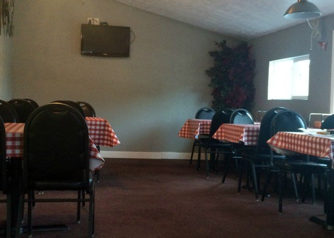 The small dining area inside Otto's has two TV's for entertainment and seating for roughly 24 people.