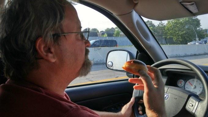 Grabbing some Krispy Kreme doughnuts on a road trip.