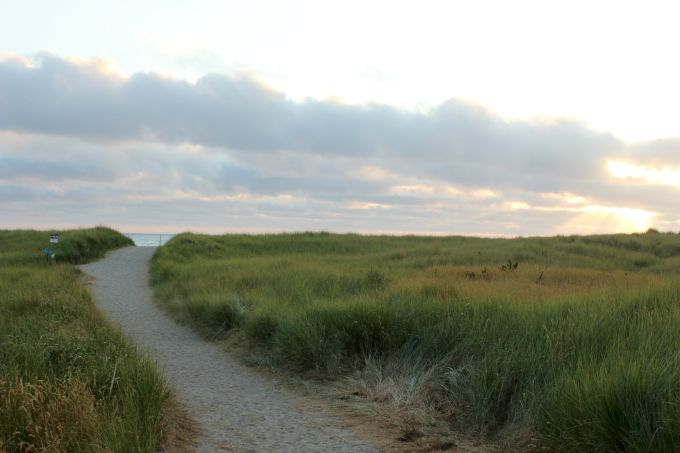 The sandy trail that leads to the beach and ocean access at Seaside in Oregon.