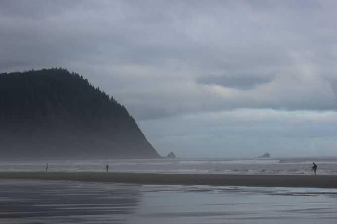 Walking along the Oregon Coast at sunrise collecting sand dollars.