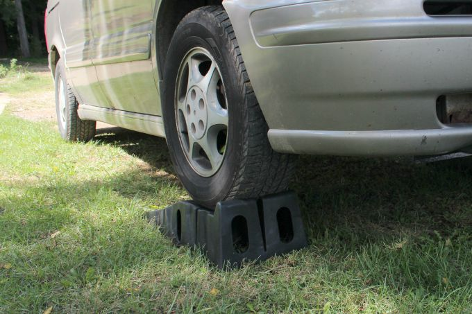 Jack the vehicle up or use ramps to get under the vehicle to change the oil.