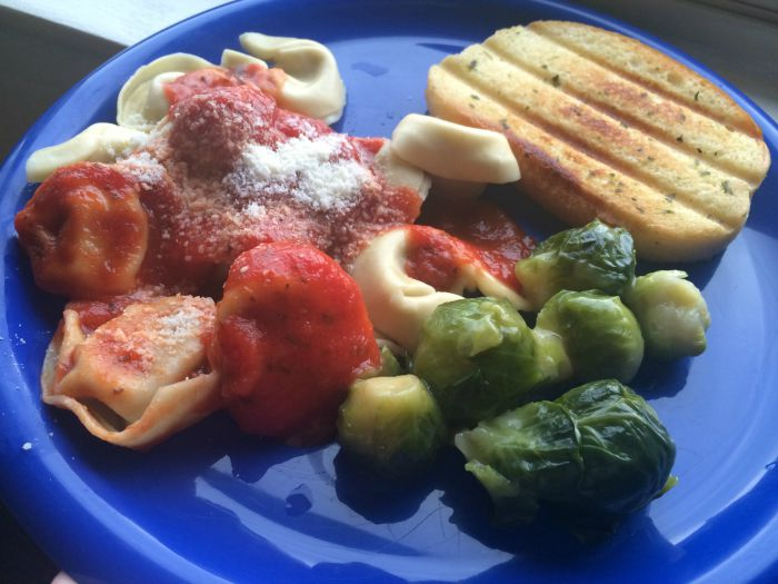 Tortellini, brussel sprouts and garlic bread- prepared in a hotel room