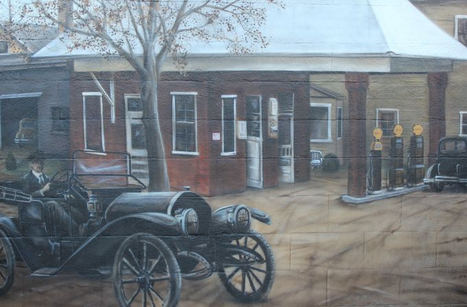 Centerburg Historical Mural- the final scene in the mural depicts the 1930's gas station that stood where the public parking lot now stands.