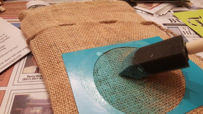 Painting a burlap bag to store my DIY road trip journal