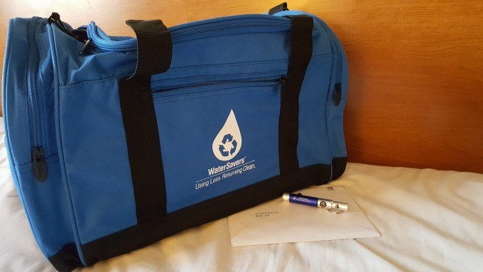 The WaterSavers Giveaway Package includes a large travel bag, a compass/flashlight keychain and a $30 Visa giftcard.