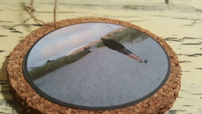 Use spray adhesive to attach the photo copy on the cork.