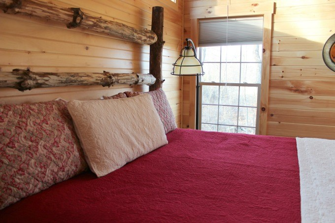 The Master Bedroom in the Bookers Cabin in Hocking Hills features a custom made bed.