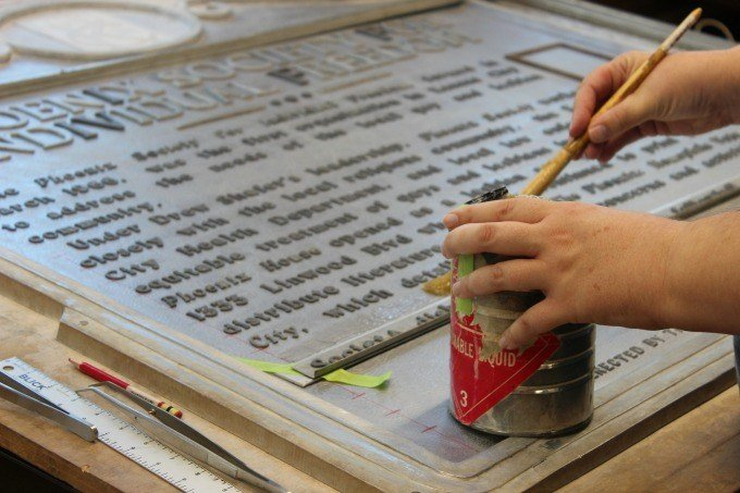The typesetting process of the historical markers is all by hand.