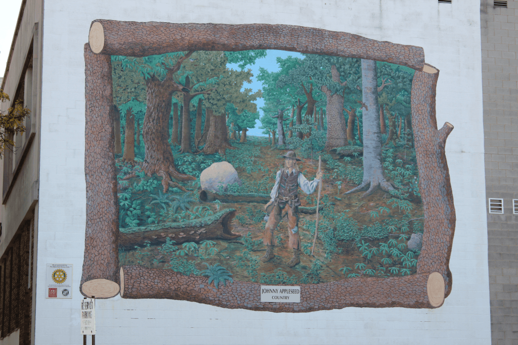 This mural of Johnny Appleseed is located on the side of a building in downtown Mansfield, Ohio.