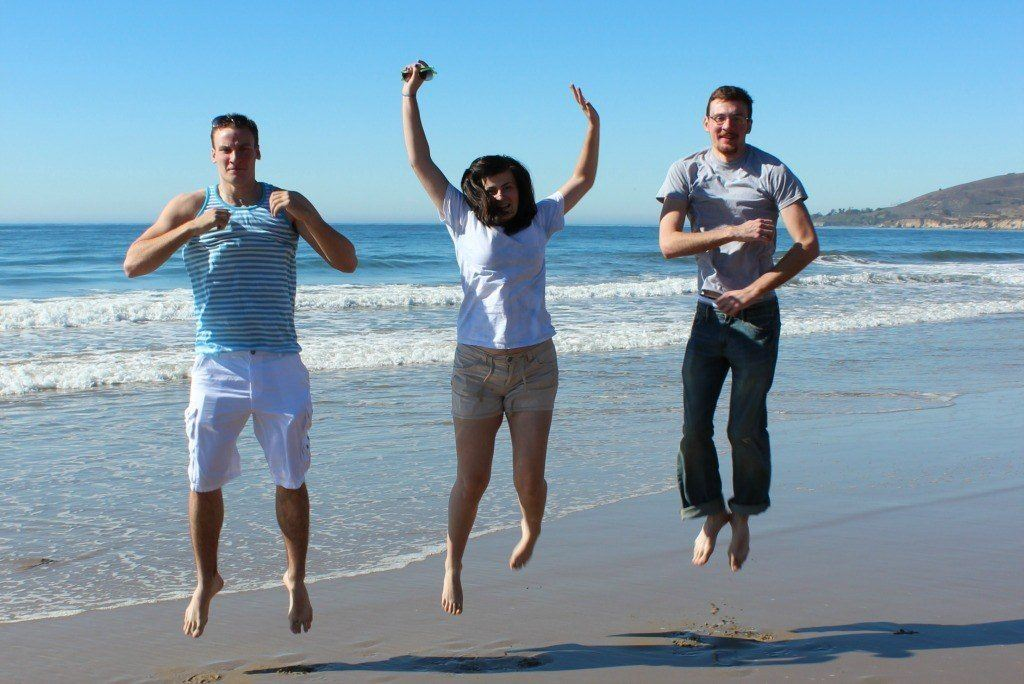 The kids jumping on the beach in California
