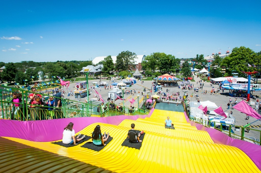 The giant yellow slide at the Ohio State Fair is one of 7 iconic attractions you must see and enjoy at the fair.
