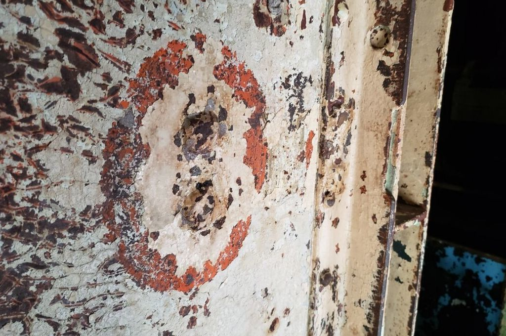 The prison has seen better days as evidenced by this photo with peeling lead paint on the walls.