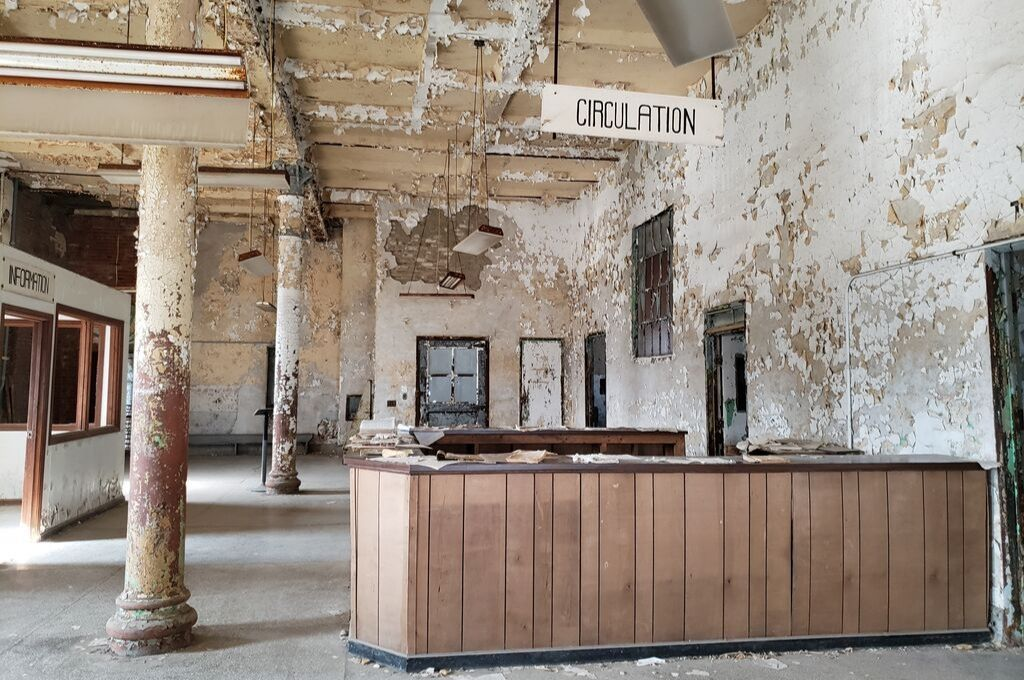 The circulation desk in the abandoned prison is pretty bleak.