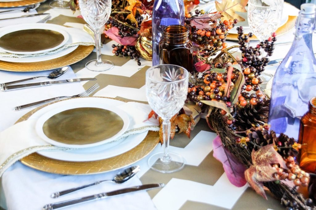 Create an amazing fall tablescape with this gold stained glass church inspired Thanksgiving tablescape.