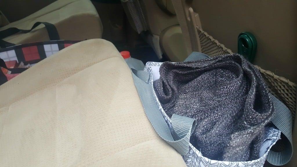 Tote behind seat