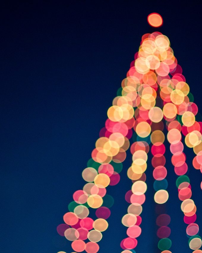 A Christmas tree lit up with lights