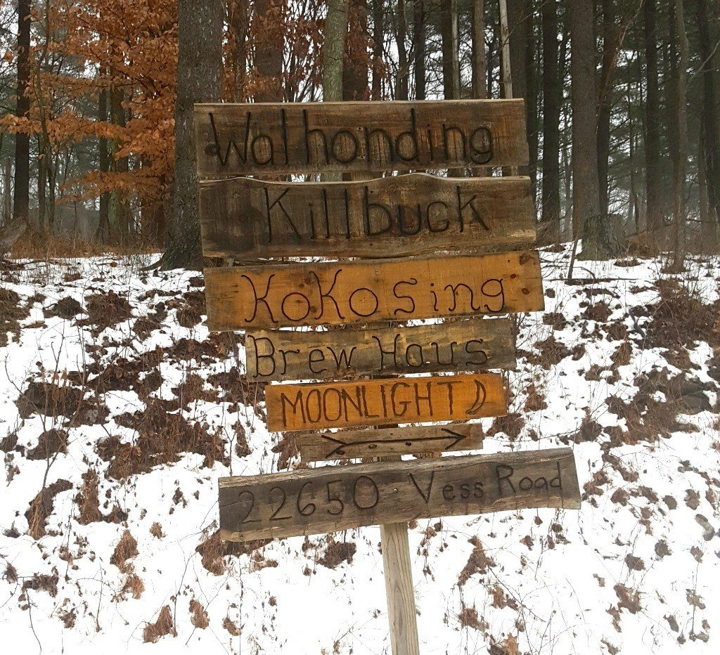 The rustic wood sign pointed the way to our cabin.