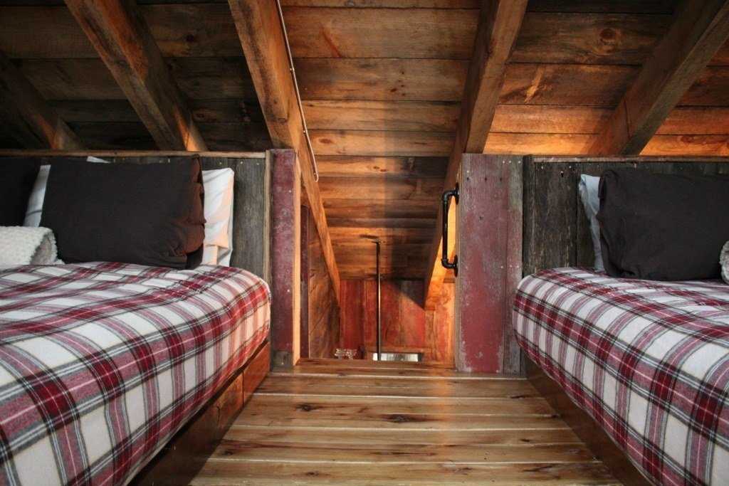 The treehouse has a loft bedroom with two queen size beds.