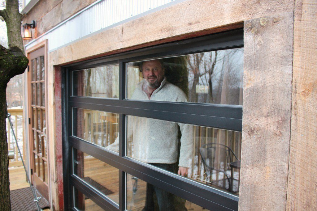 The garage door in the Tin Shed Treehouse opens up to extend the living space.