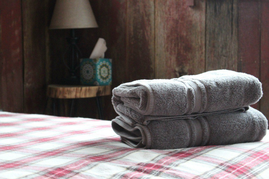 Towels on the bed.