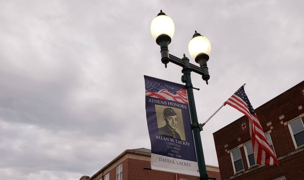 Downtown Athens Ohio has banners on the street lights honoring Veterans.