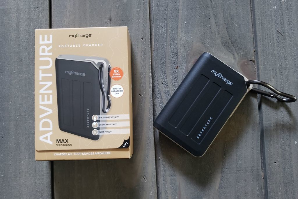 myCharge Portable Adventure Charger on a table with the packaging.