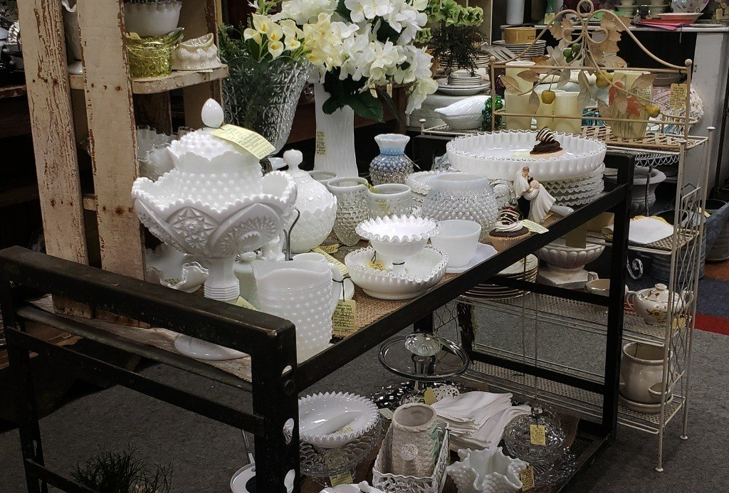 table full of milk glass