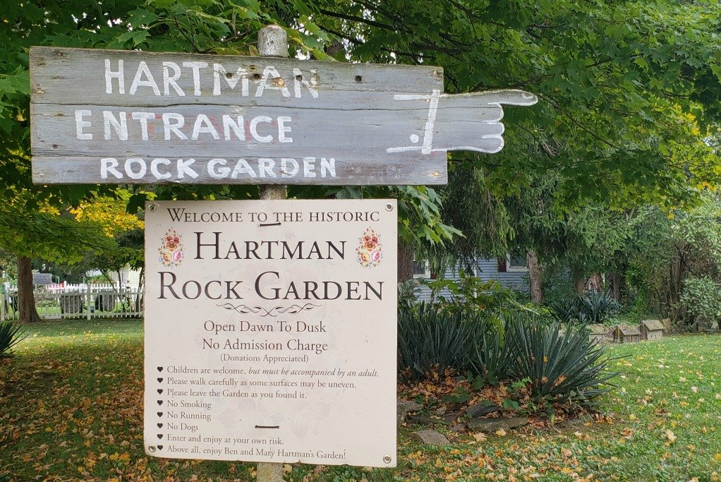 This sign leads the way to the Hartman Rock Garden.