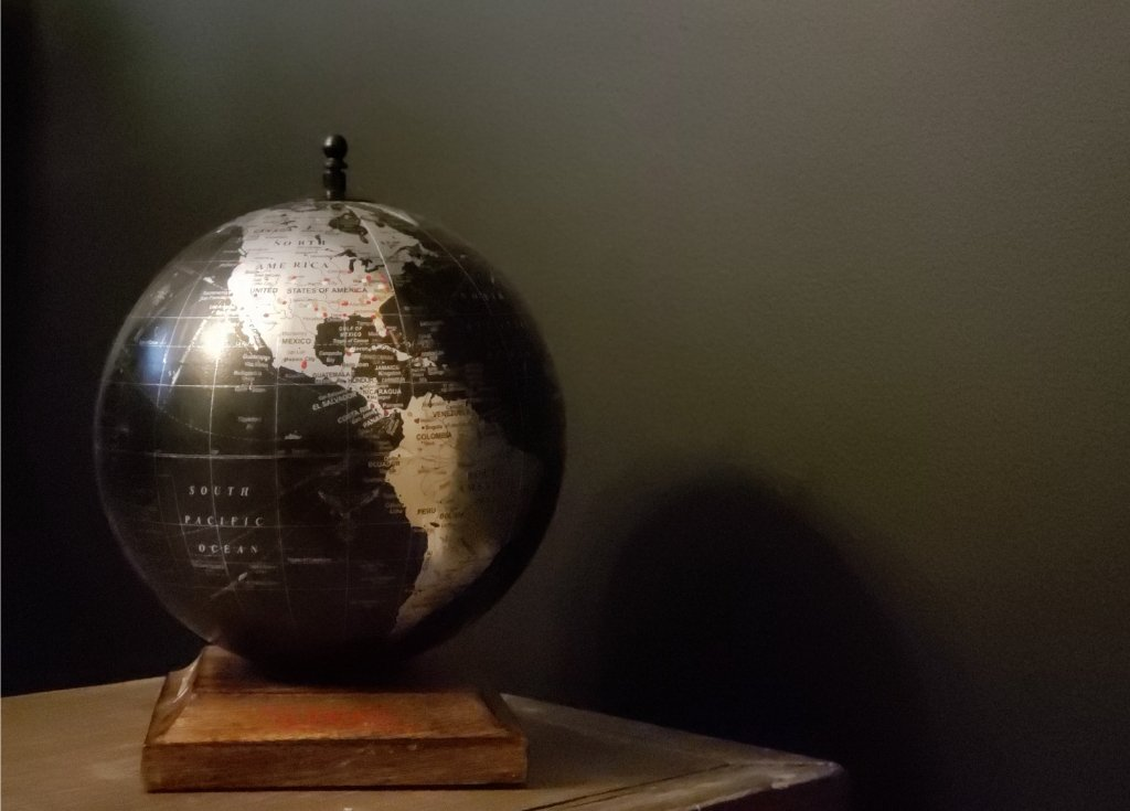 A globe showing where each member of the family has traveled individually and where we've traveled as a family.