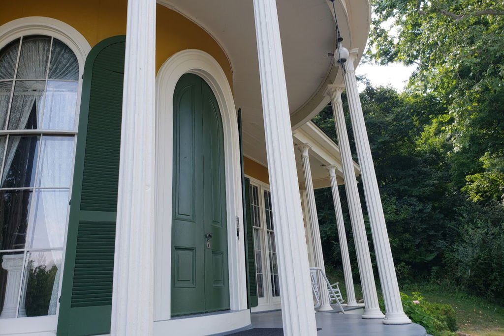 The front porch of the Hillforest Mansion is a unique curved design