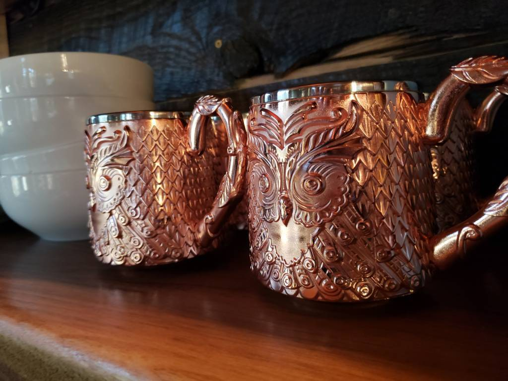 Love these copper looking owl cups in the kitchen.
