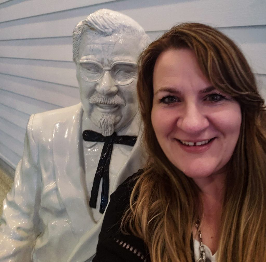 A photo of me and the Col Sanders statue