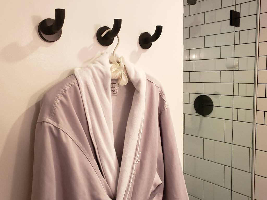 A robe hanging on a hanger.